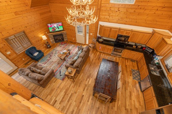 Looking down at the main floor at Smoky Mountain Escape, a 3 bedroom cabin rental located in Pigeon Forge