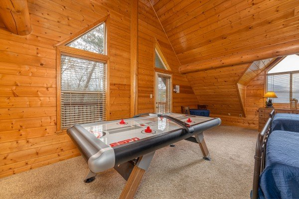 Air hockey table at Smoky Mountain Escape, a 3 bedroom cabin rental located in Pigeon Forge