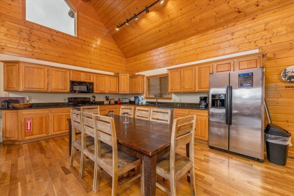 Dining table for 8 at Smoky Mountain Escape, a 3 bedroom cabin rental located in Pigeon Forge