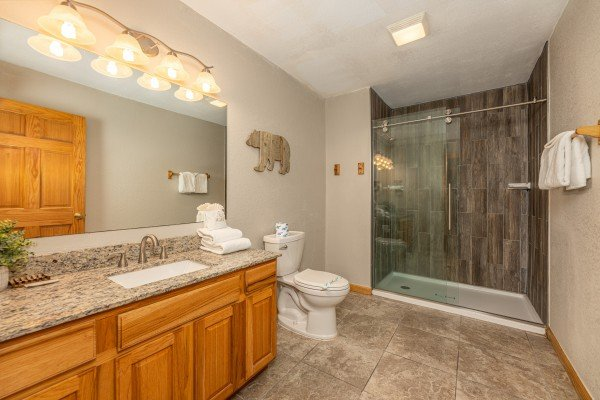 Bathroom with a walk in shower at Smoky Mountain Escape, a 3 bedroom cabin rental located in Pigeon Forge