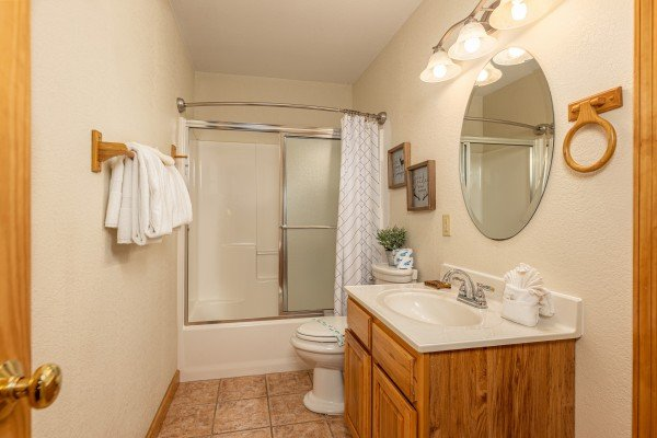 Bathroom with a tub and shower at Smoky Mountain Escape, a 3 bedroom cabin rental located in Pigeon Forge