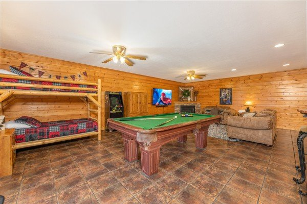 Game room with bunk beds and pool table at Smoky Mountain Escape, a 3 bedroom cabin rental located in Pigeon Forge