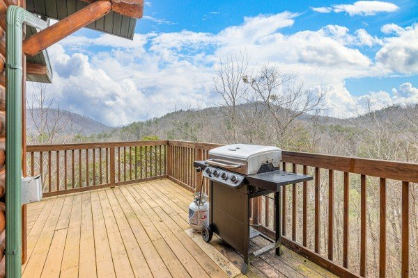 Grill on a deck at Smoky Mountain Escape, a 3 bedroom cabin rental located in Pigeon Forge