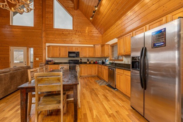 Kitchen and dining at Smoky Mountain Escape, a 3 bedroom cabin rental located in Pigeon Forge