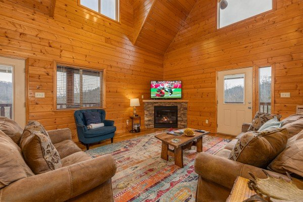 Living room with TV and fireplace at Smoky Mountain Escape, a 3 bedroom cabin rental located in Pigeon Forge