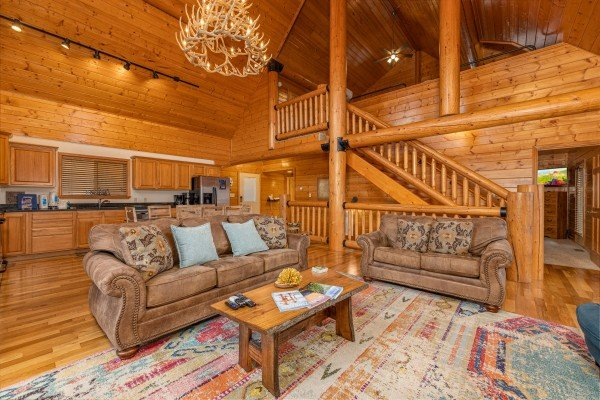 Sofa and loveseat in a living room at Smoky Mountain Escape, a 3 bedroom cabin rental located in Pigeon Forge