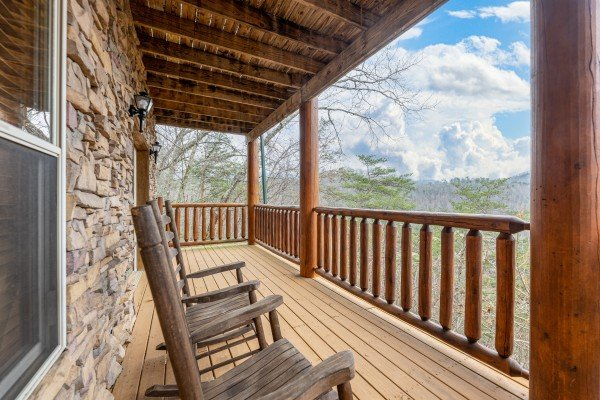 Rocking chairs on the lower deck at Smoky Mountain Escape, a 3 bedroom cabin rental located in Pigeon Forge