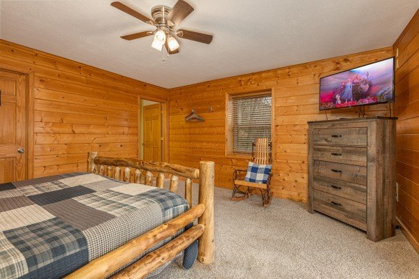 Dresser, rocking chair, and TV in a bedroom at Smoky Mountain Escape, a 3 bedroom cabin rental located in Pigeon Forge