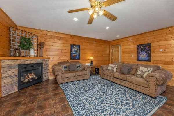 Sofa and loveseat in the lower living room at Smoky Mountain Escape, a 3 bedroom cabin rental located in Pigeon Forge