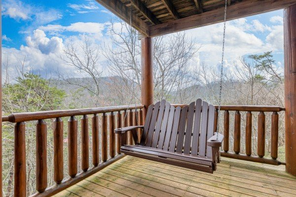 Porch swing at Smoky Mountain Escape, a 3 bedroom cabin rental located in Pigeon Forge