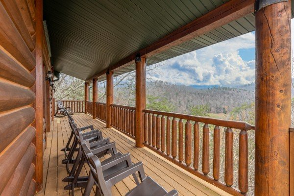 Rocking chairs and a mountain view on the deck at Smoky Mountain Escape, a 3 bedroom cabin rental located in Pigeon Forge