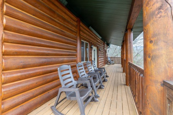 Rocking chairs on a covered deck at Smoky Mountain Escape, a 3 bedroom cabin rental located in Pigeon Forge