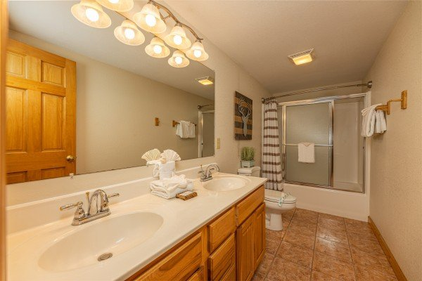 Bathroom with tub and shower at Smoky Mountain Escape, a 3 bedroom cabin rental located in Pigeon Forge