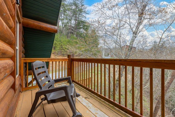 Rocking chair on the upper deck at Smoky Mountain Escape, a 3 bedroom cabin rental located in Pigeon Forge