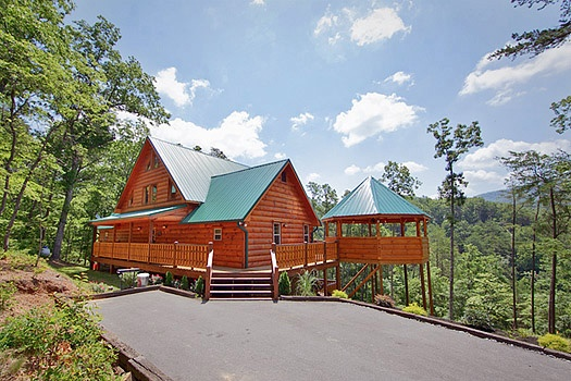 Exterior back view with parking area at Rainbow's End, a 4 bedroom cabin rental located in Pigeon Forge