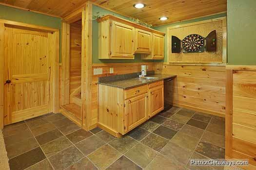 Game room with dart board at Rainbow's End, a 4 bedroom cabin rental located in Pigeon Forge