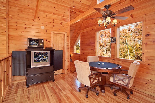 game room with poker table at rainbow's end a 4 bedroom cabin rental located in pigeon forge