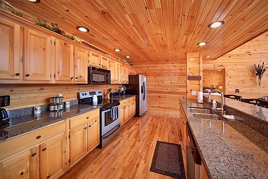 kitchen with stainless steel appliances at rainbow's end a 4 bedroom cabin rental located in pigeon forge
