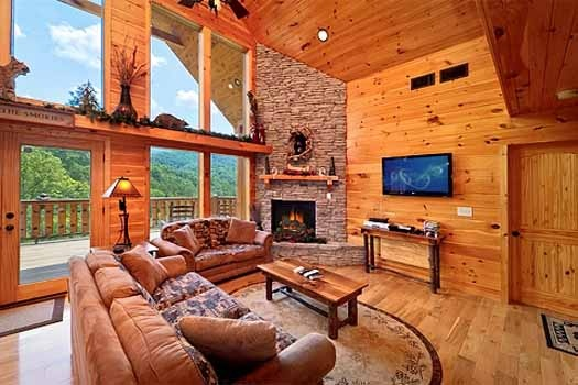 living room with cathedral ceilings at rainbow's end a 4 bedroom cabin rental located in pigeon forge