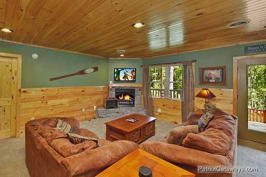 living room with fireplace at rainbow's end a 4 bedroom cabin rental located in pigeon forge