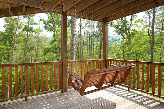 lower deck with porch swing at rainbow's end a 4 bedroom cabin rental located in pigeon forge