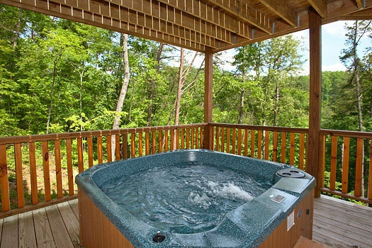 Lower level deck with hot tub at Rainbow's End, a 4 bedroom cabin rental located in Pigeon Forge
