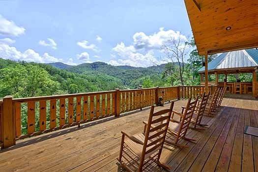 Main level deck with rockers at Rainbow's End, a 4 bedroom cabin rental located in Pigeon Forge