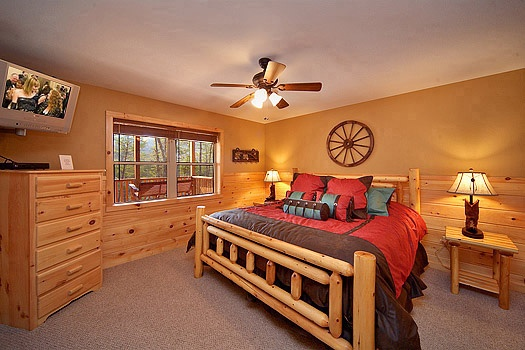 main level king bedroom at rainbow's end a 4 bedroom cabin rental located in pigeon forge