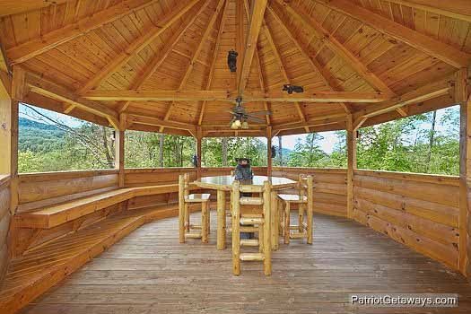 patio table in gazebo at rainbow's end a 4 bedroom cabin rental located in pigeon forge
