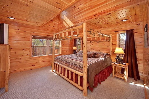 second level king bedroom at rainbow's end a 4 bedroom cabin rental located in pigeon forge