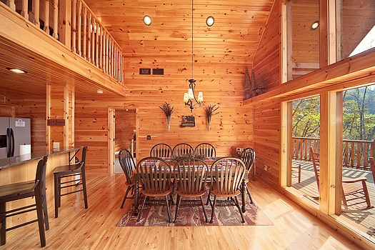 two story dining area at rainbow's end a 4 bedroom cabin rental located in pigeon forge
