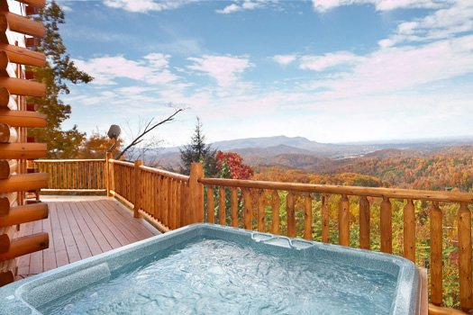 Deck with hot tub at The Original American Dream, a 2 bedroom cabin rental located in Gatlinburg
