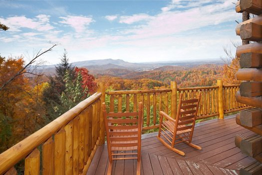 Deck with rockers at The Original American Dream, a 2 bedroom cabin rental located in Gatlinburg