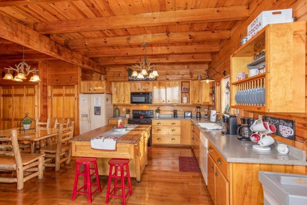 Large kitchen with bar stools at The Original American Dream, a 2 bedroom cabin rental located in Gatlinburg