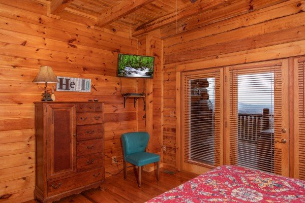 Television in the master bedroom at The Original American Dream, a 2 bedroom cabin rental located in Gatlinburg
