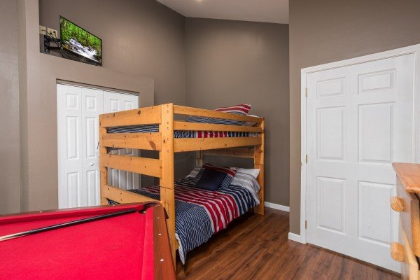 Room with full-sized bunk bed and a pool table at Gatlinburg Movie Mansion, a 5-bedroom cabin rental located in Gatlinburg