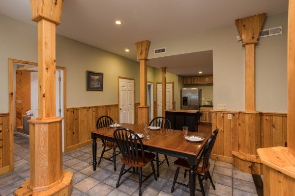 Dining space for four at Gatlinburg Movie Mansion, a 5-bedroom cabin rental located in Gatlinburg