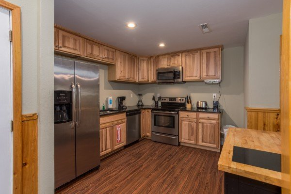 Kitchen with stainless appliances at Gatlinburg Movie Mansion, a 5-bedroom cabin rental located in Gatlinburg