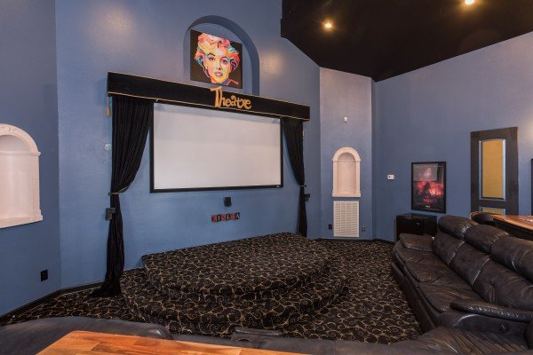 Theater room with a stage and screen at Gatlinburg Movie Mansion, a 5-bedroom cabin rental located in Gatlinburg