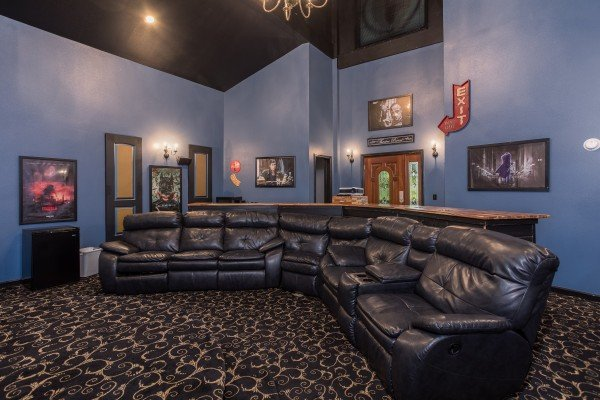 Large sectional couch in the theater room at Gatlinburg Movie Mansion, a 5-bedroom cabin rental located in Gatlinburg