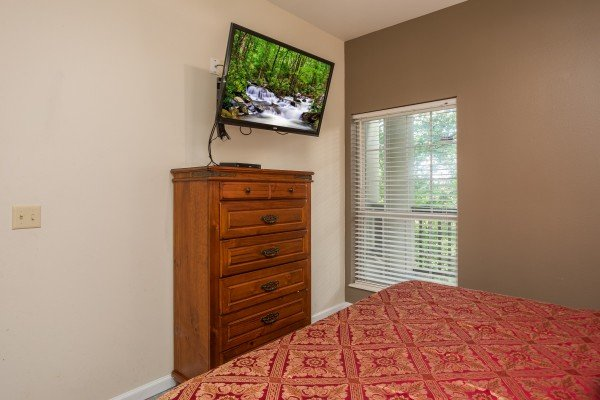Bedroom with a dresser and TV at Gatlinburg Movie Mansion, a 5-bedroom cabin rental located in Gatlinburg