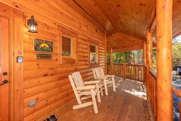Front porch with two log chairs at Panorama, a 2 bedroom cabin rental located in Pigeon Forge