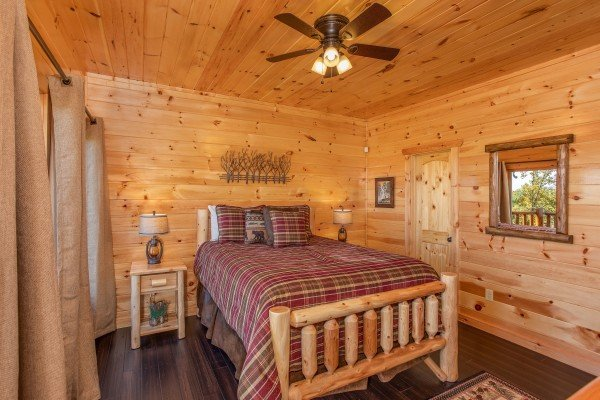 Bedroom with a log bed and two end tables at Panorama, a 2 bedroom cabin rental located in Pigeon Forge