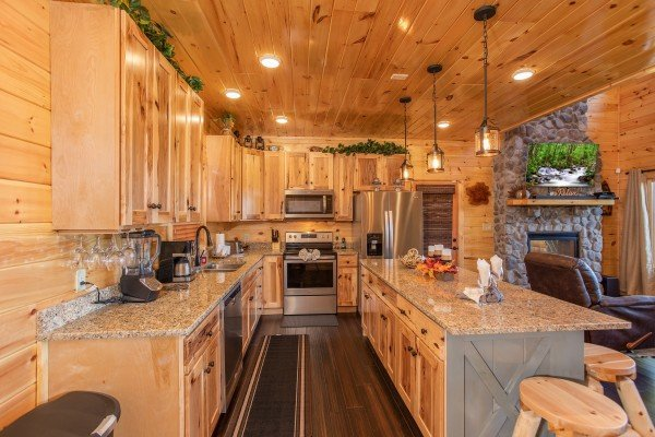 Kitchen with granite counters and stainless appliances at Panorama, a 2 bedroom cabin rental located in Pigeon Forge