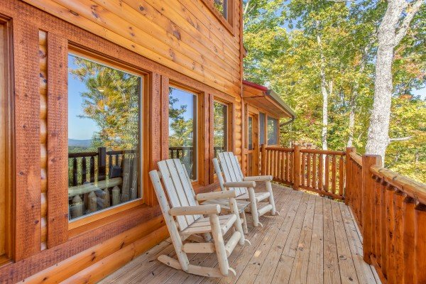 Log rocking chairs at Panorama, a 2 bedroom cabin rental located in Pigeon Forge