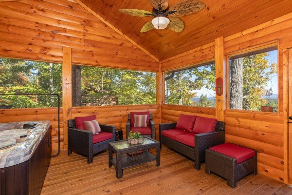 Seating area on the screened in porch at Panorama, a 2 bedroom cabin rental located in Pigeon Forge