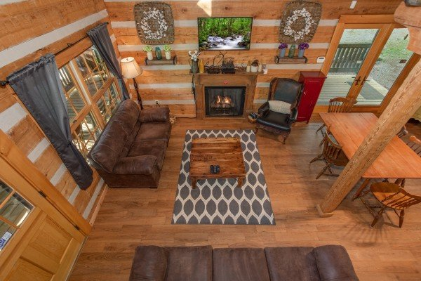 Looking down into the living and dining spaces at Trillium Lodge, a 4 bedroom cabin rental located in Gatlinburg