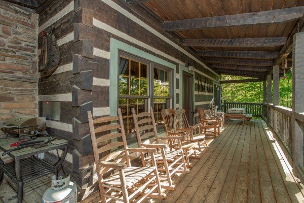 Rocking chairs on the deck at Trillium Lodge, a 4 bedroom cabin rental located in Gatlinburg