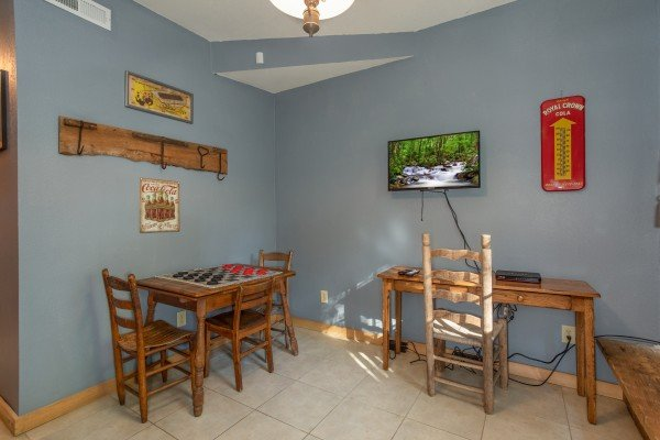 Game room with checkers and a TV at Trillium Lodge, a 4 bedroom cabin rental located in Gatlinburg