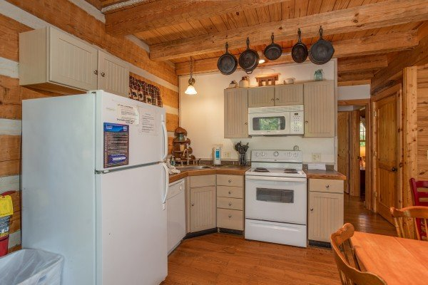 Kitchen with white appliances at Trillium Lodge, a 4 bedroom cabin rental located in Gatlinburg